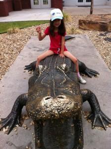Jezebel Rides a Crocodile at the Oklahoma Aquarium